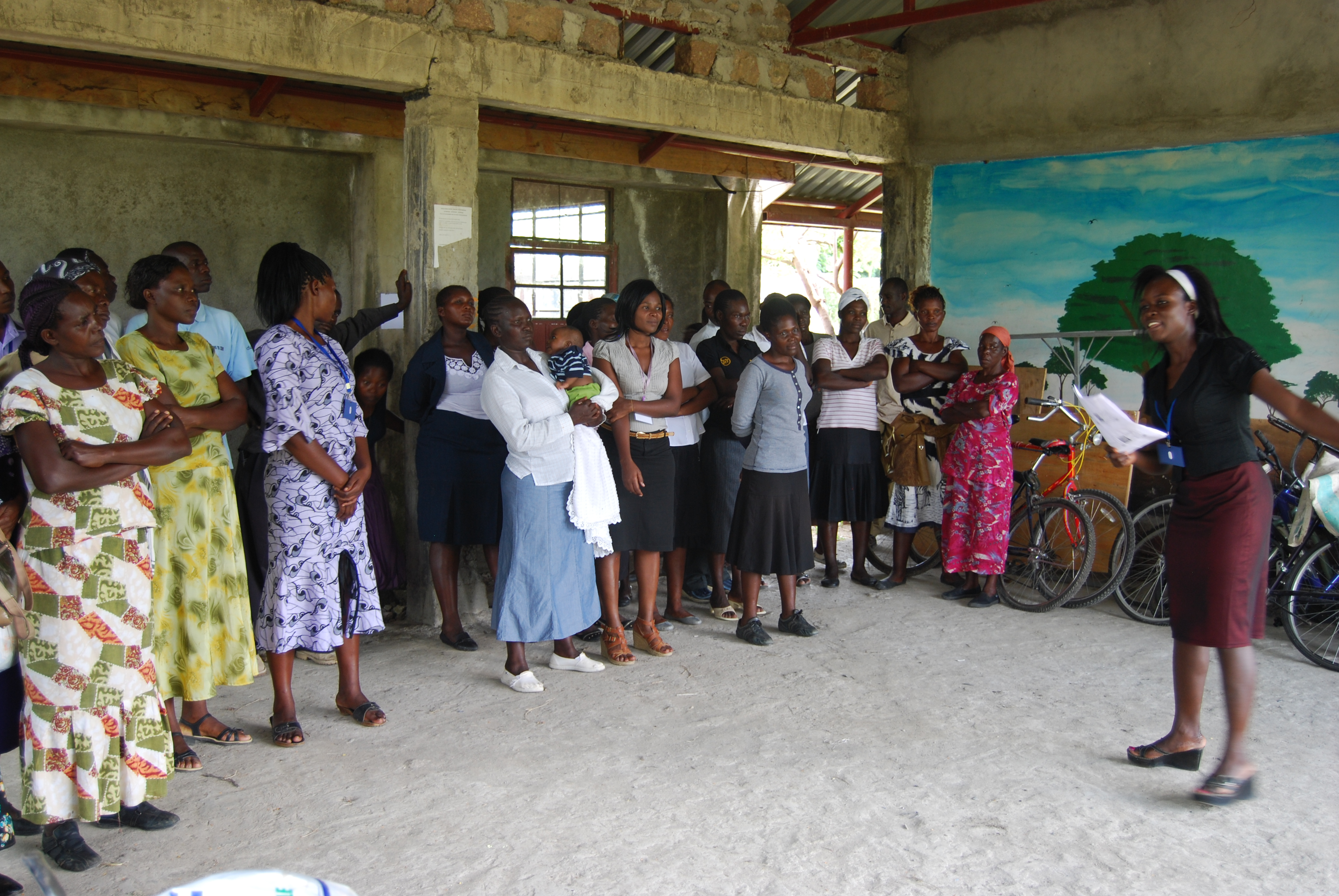 EK Nutrition Counselor Florida Otieno leads a group in a food security activity.